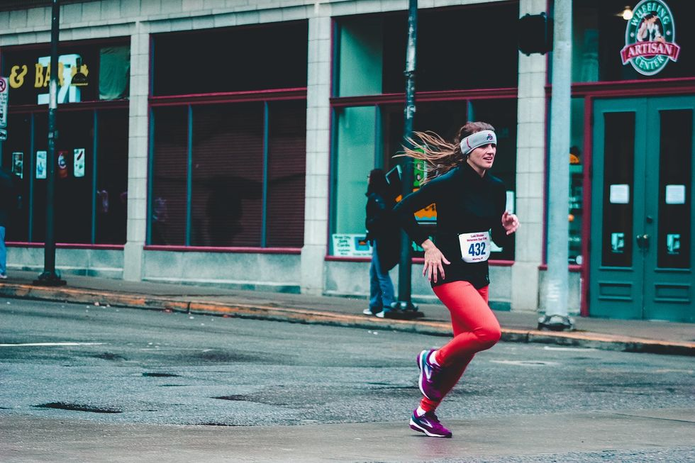 https://www.pexels.com/photo/woman-wearing-red-pants-and-black-long-sleeved-top-running-1564466/