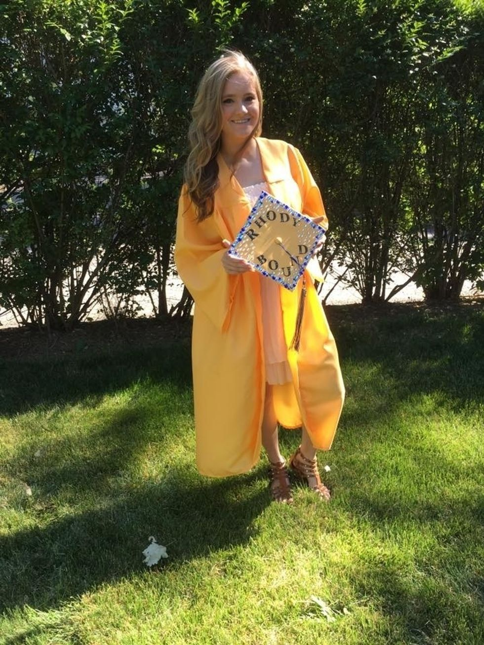 woman in high school graduation gown