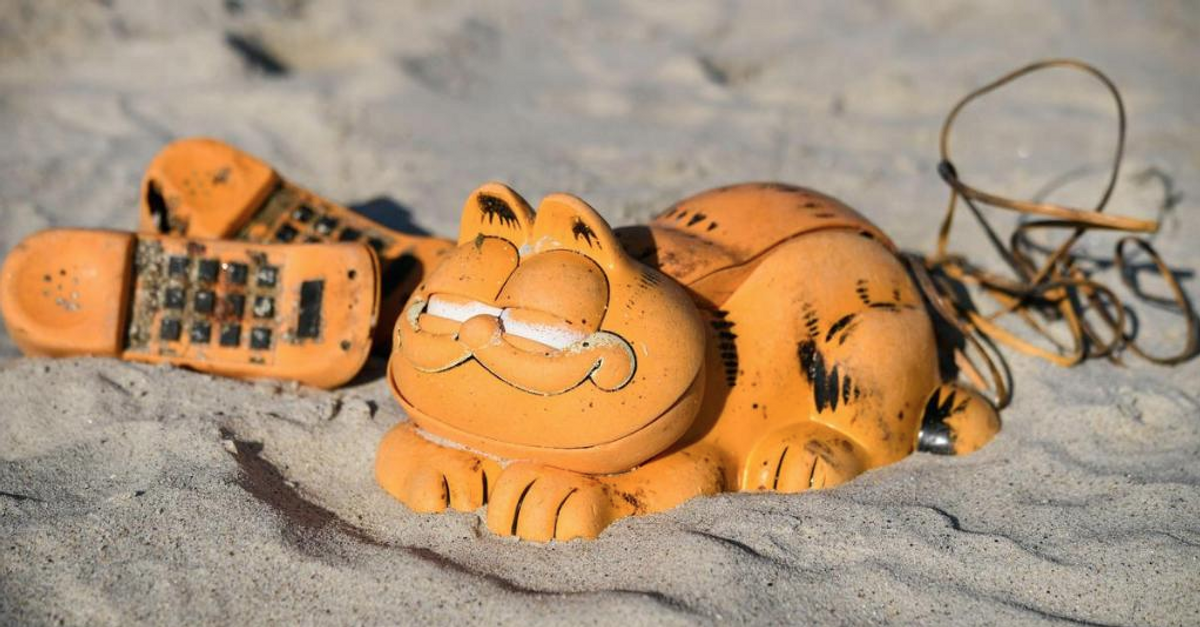 Garfield Phones Have Been Washing Up On A Beach In France For 30 Years