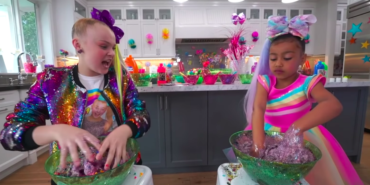 Jojo Siwa And North West Make Slime And Wear Rainbow Outfits In New Video