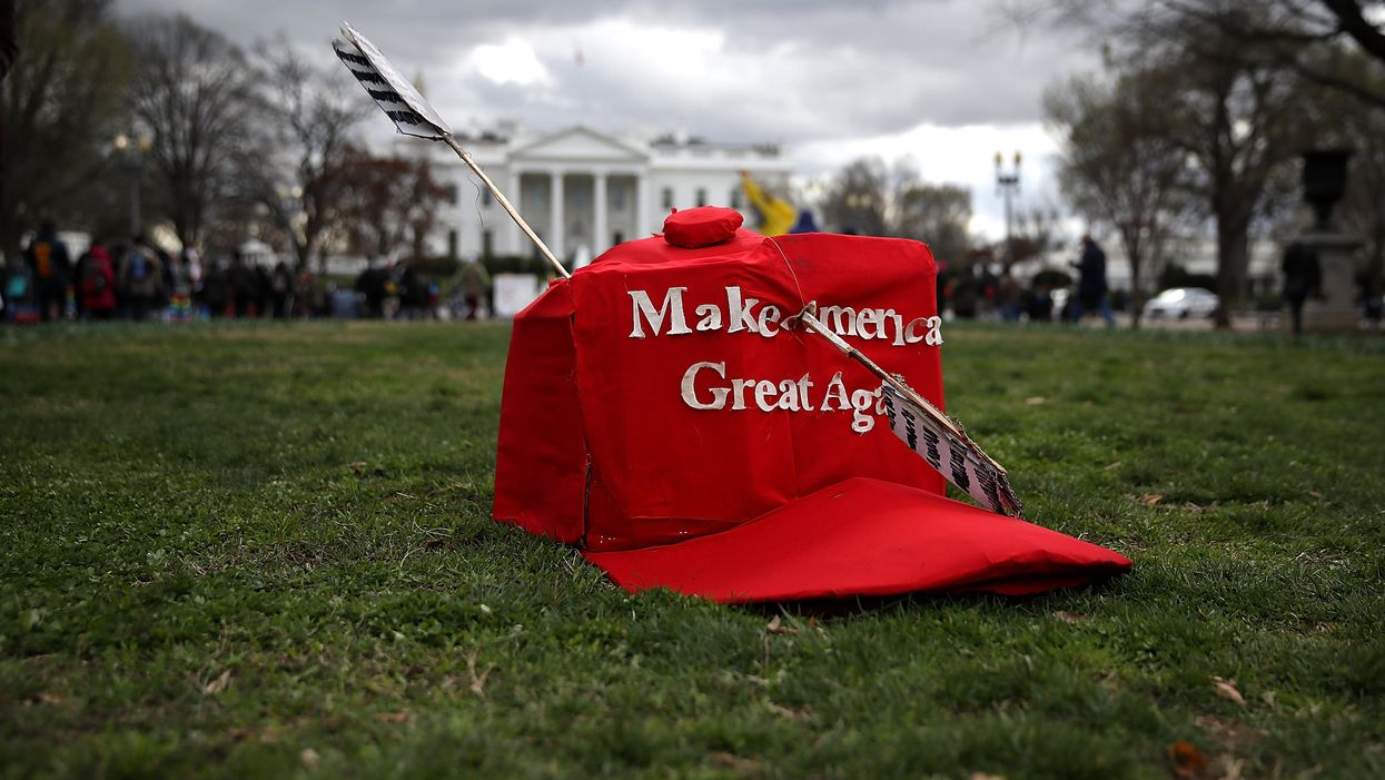 Woman harasses, threatens elderly man wearing a 'Make America Great Again' hat with mob. Karma kicks in so fast.
