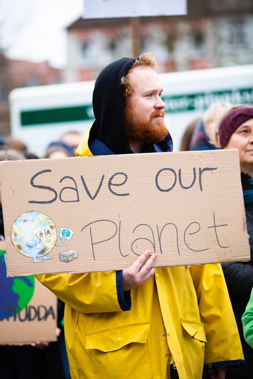 https://www.pexels.com/photo/person-holding-save-our-planet-sign-2027058/