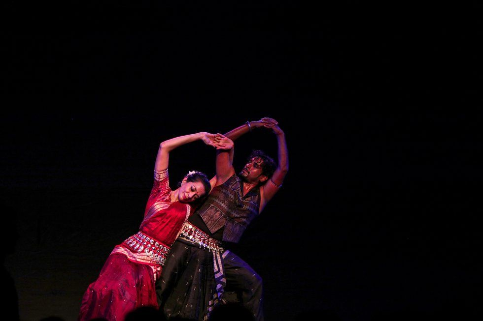 A male and female Indian dancer perform
