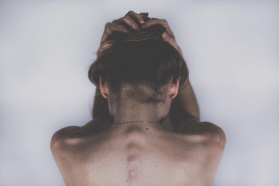 https://pixabay.com/photos/woman-sad-depression-headache-2609115/