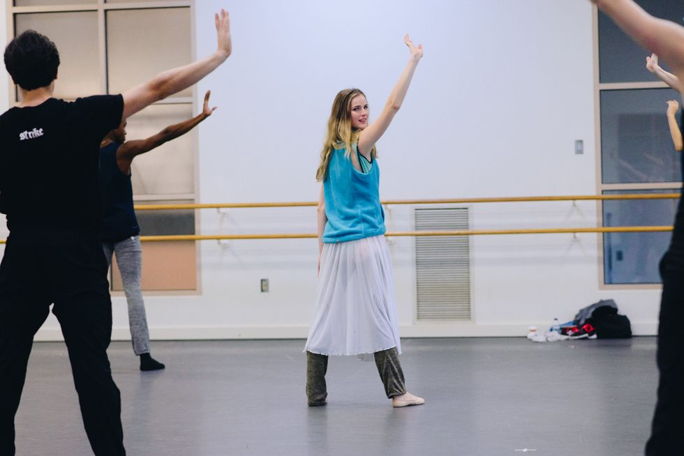 Sage Humphries leads a rehearsal at the Boston Ballet studios, demonstrating one hand up