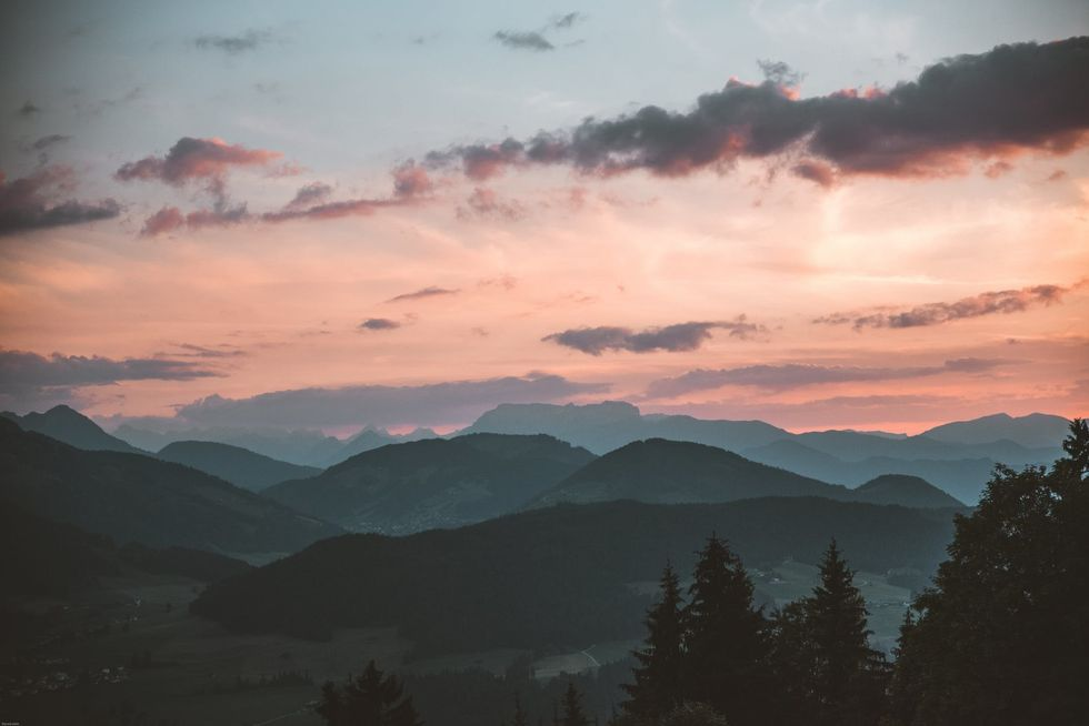 https://www.pexels.com/photo/scenic-view-of-mountains-during-dawn-1261728/