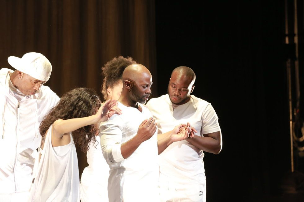 Marc Bamuthi Joseph and dancers on stage in white
