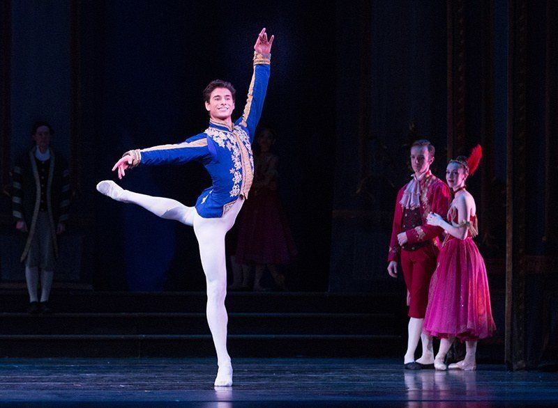 Baca in a classical ballet piece, facing the audience with his back leg in attitude.