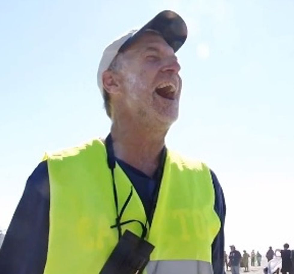 VIDEO: What Is That Cab Driver Doing With A Helicopter, 1,000 Bodies, And That Much Sand?