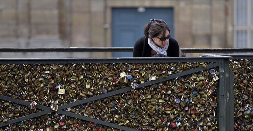 Love locks nearly destroyed this bridge, but the city is repurposing them in the best way.