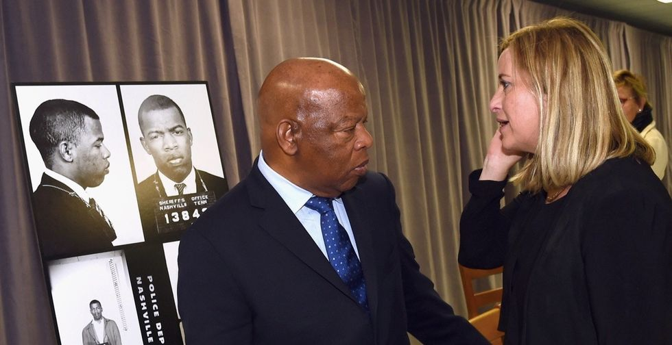 John Lewis was overcome with emotion at the sight of his old mugshot.