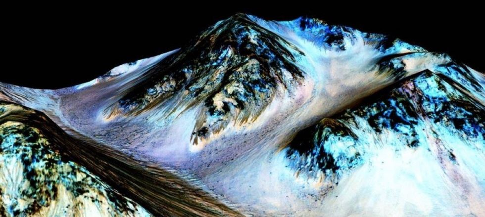NASA just found out what these dark streaks on Mars are, and it's game-changing.