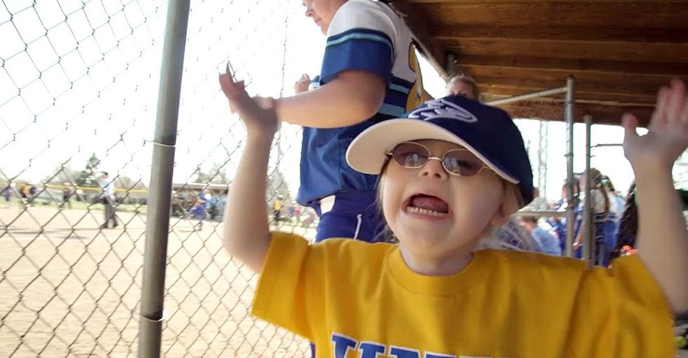 Down syndrome didn't stop this girl from rocking her first softball game.