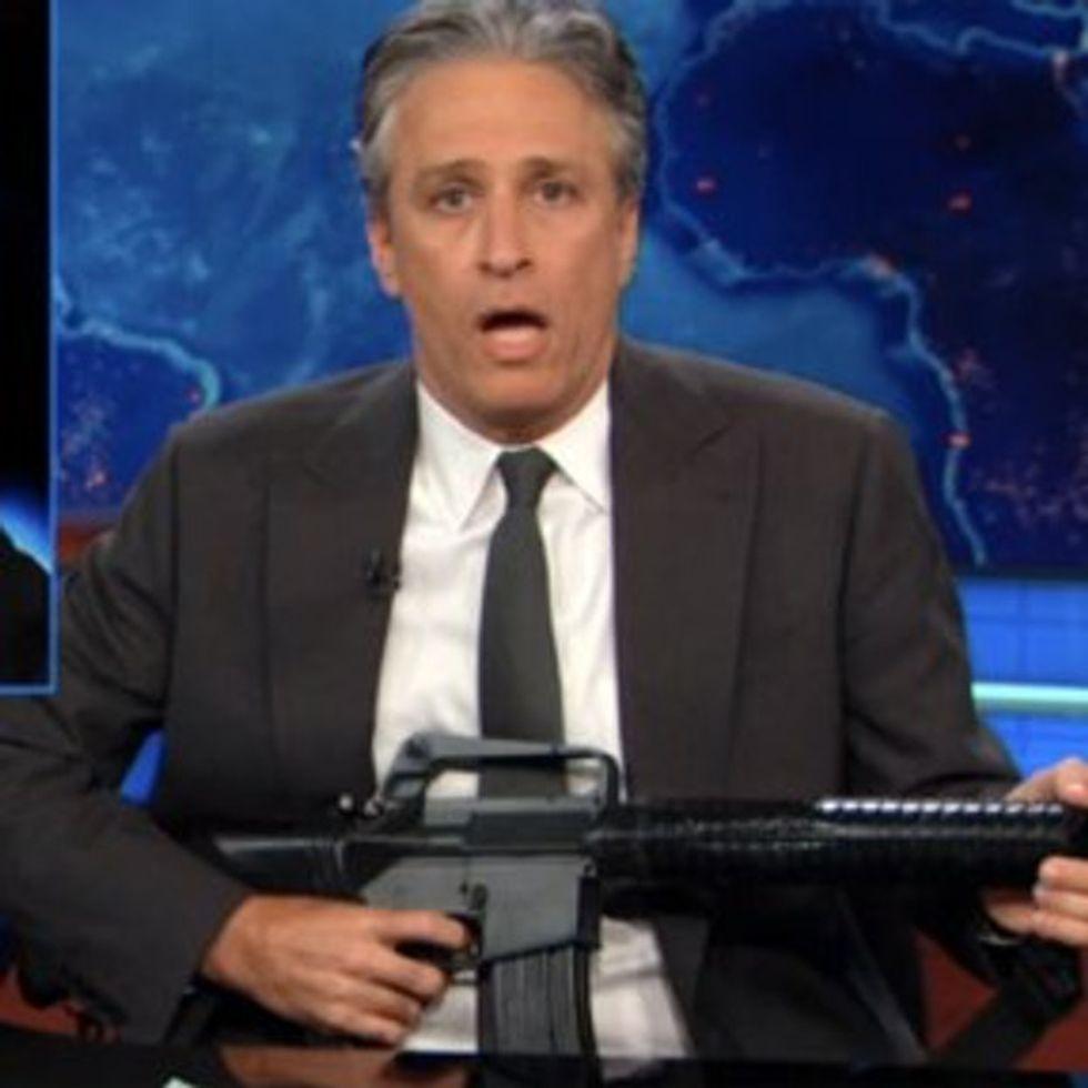 Why Is Jon Stewart Wielding A Gun On Television? Oh, Right. Fox News.