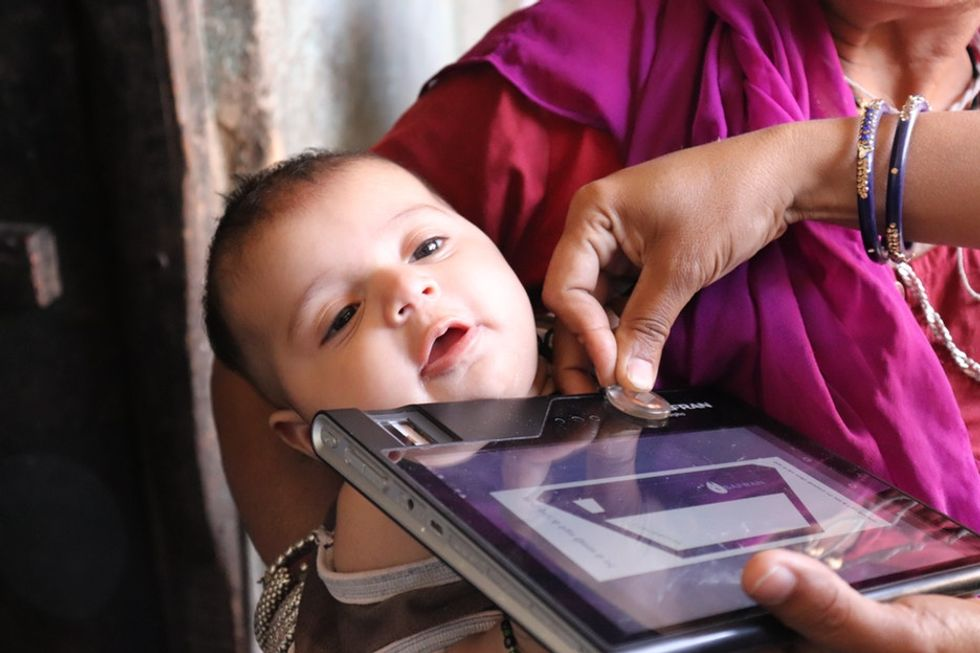 The amazing reason mothers in India are giving their babies wearable medical records.