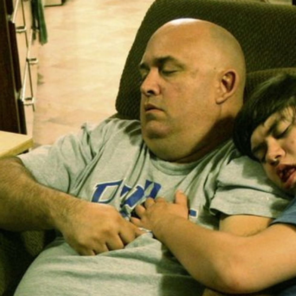 Every Night This Dad Falls Asleep In Front Of The TV. There's A Beautiful Reason Why.