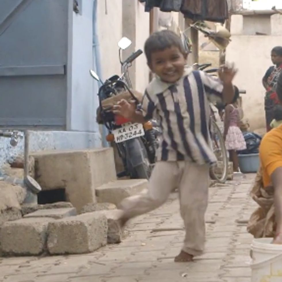 Can You Guess Why This Adorable Little Boy Is Dancing In The Street?