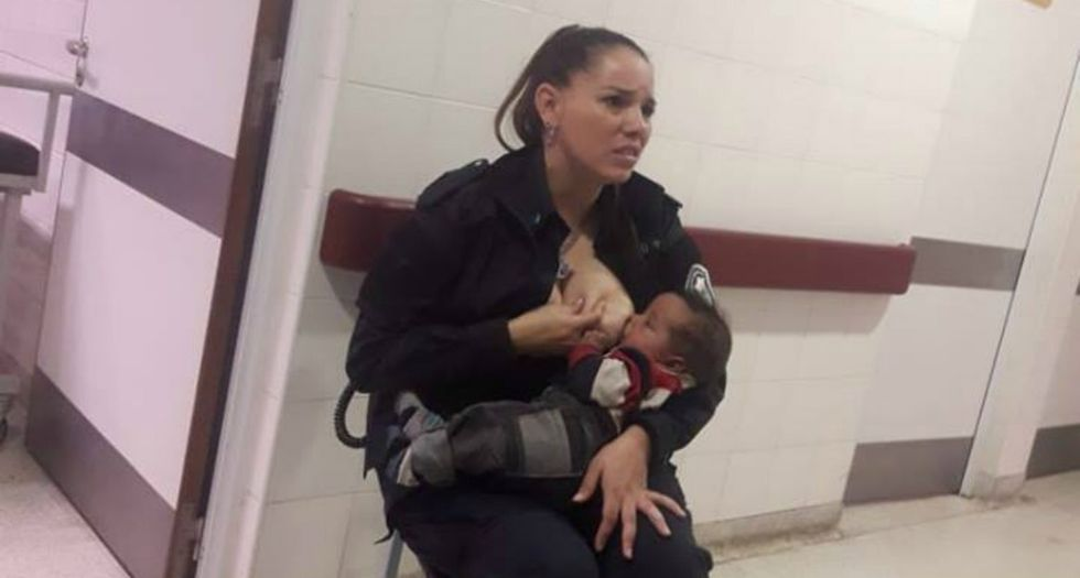 Photo of police officer breastfeeding a stranger's hungry infant is warming hearts around the world.