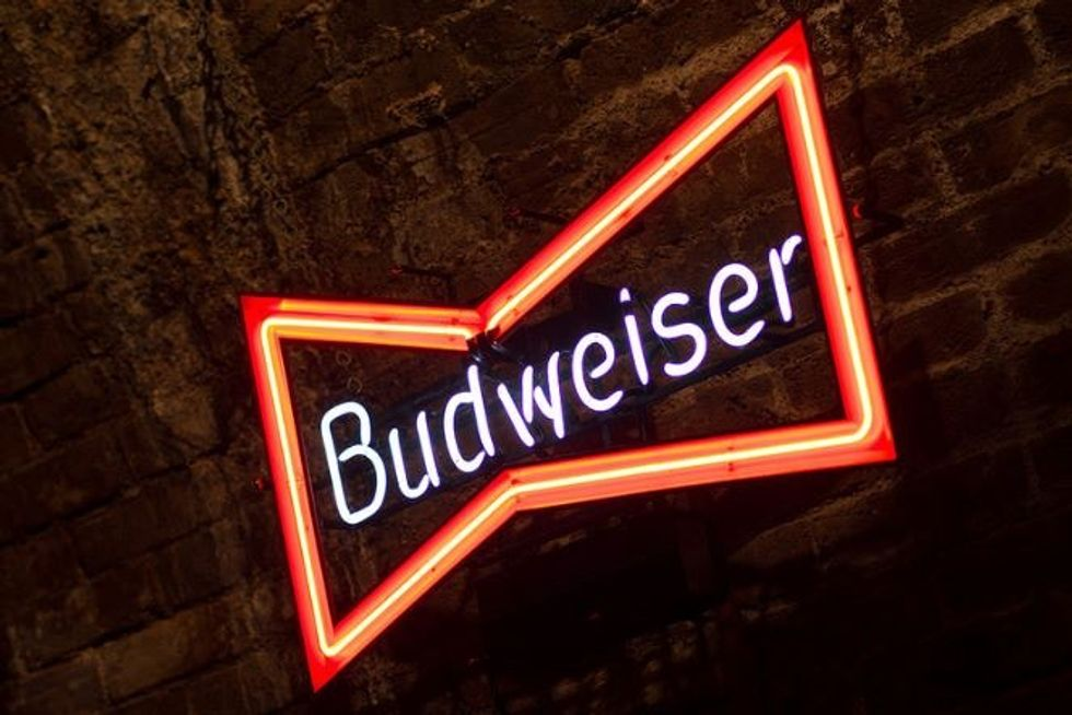 Budweiser tries to apologize for old sexist ads by re-doing some of them for today's woman.