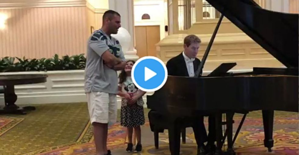 This dad singing 'Ave Maria' at a Disney resort is magic. Just watch his daughter's face.