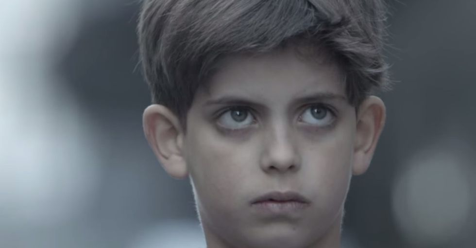 Watch An Abused Child Get A Secret Help Message In Broad Daylight That His Abuser Can't See