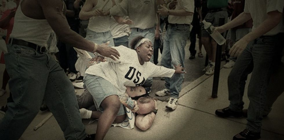 Here's The Moment A Black Woman Protected A White Man At A KKK Rally