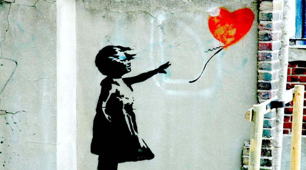 Banksy Has Updated His Famous 'The Girl With The Balloon' Artwork To Stand With Syria