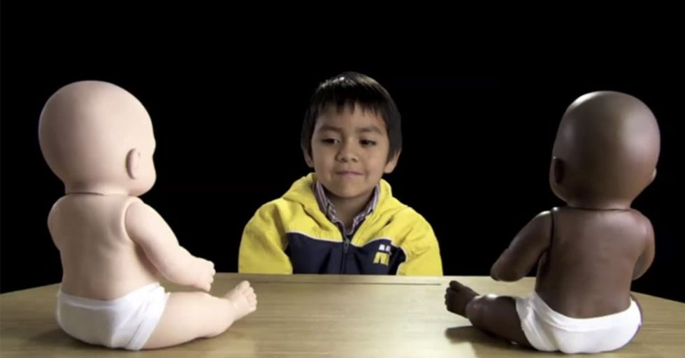 Here's What Happens When You Put A Few Little Kids In A Room With 2 Dolls In 2 Different Colors