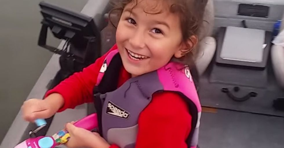 An adorable video of little girl reeling in a fish can teach us all a lesson.