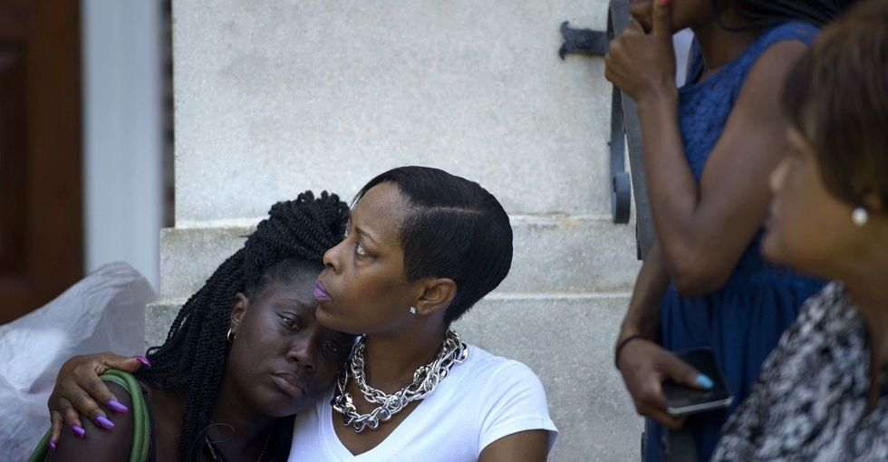 In the wake of tragedy, Charleston mourns as the world reacts.
