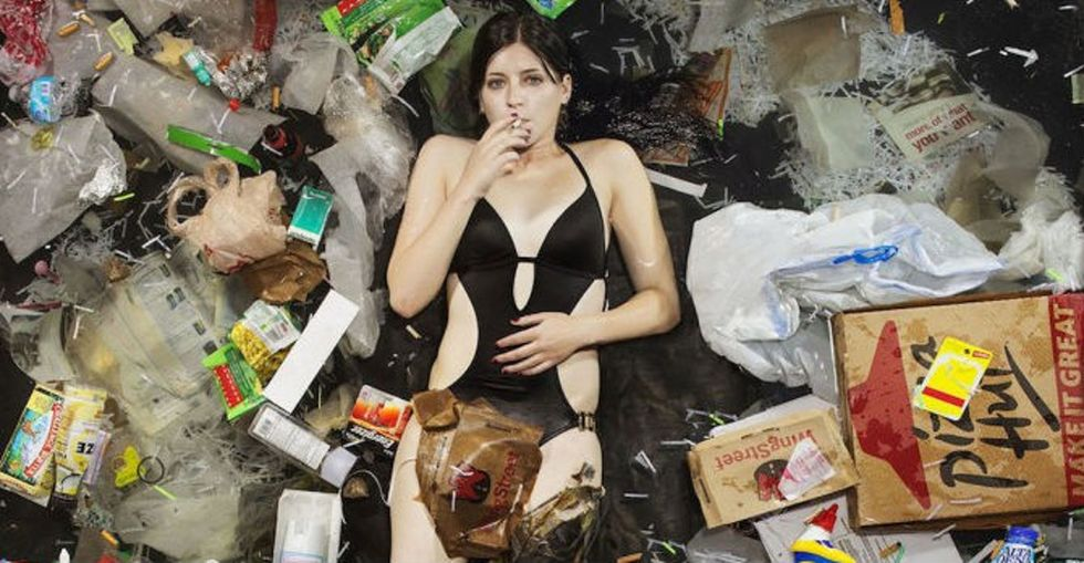 An Artist Shows What 7 Days Of Consumption Looks Like By Having People Lie In Their Own Garbage