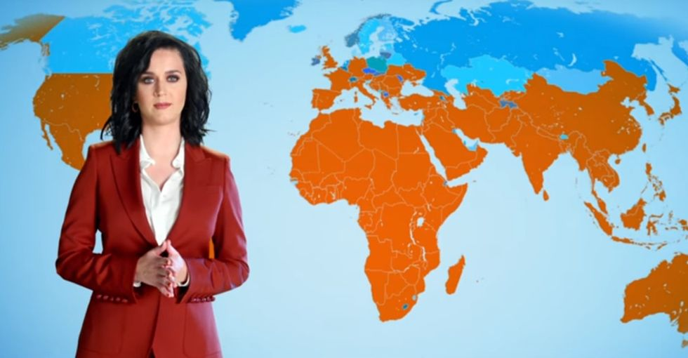 Watch Katy Perry pretend to be a meteorologist to fight global warming.