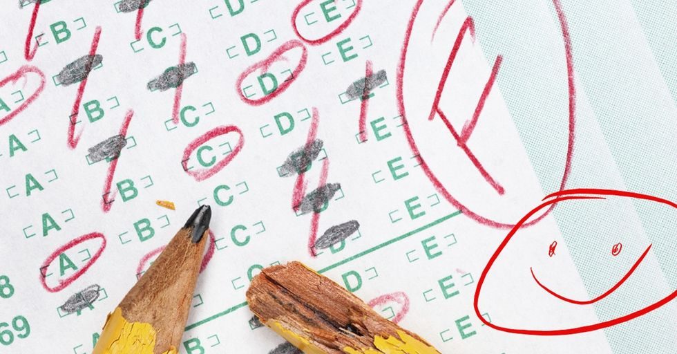 A teacher gave a student an 'F' and a smiley face. But she wasn't making fun of him.