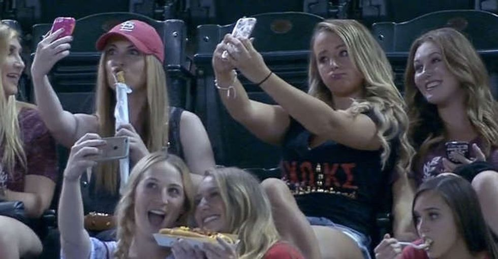 These girls were mocked on TV for taking selfies at a baseball game. Here's why that's not cool.