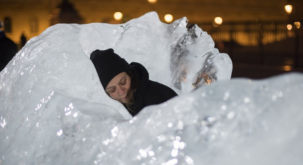 Parisians hug, touch, and cuddle with these giant blocks of ice — just like the artist wanted.