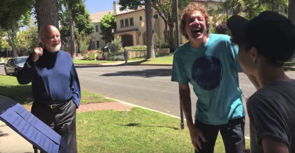 2 fans took a risk by showing up at their hero's house. Then he surprised them.