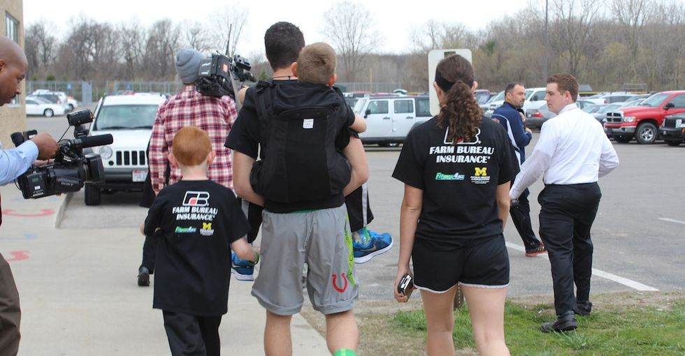 The amazing reason this kid carried his little brother on his back for 111 miles.