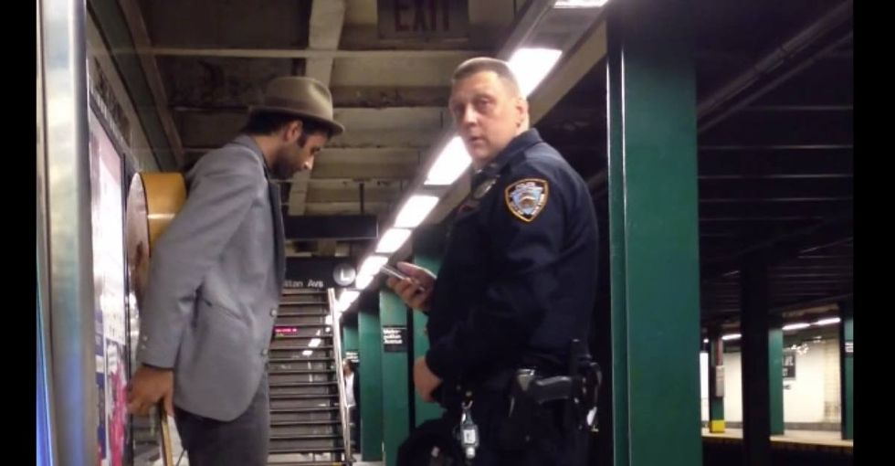 Cop doesn't understand how law works, arrests guy who does for something totally legal.