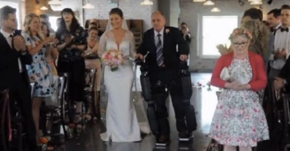 A paralyzed dad lived his dream by walking his daughter down the aisle.