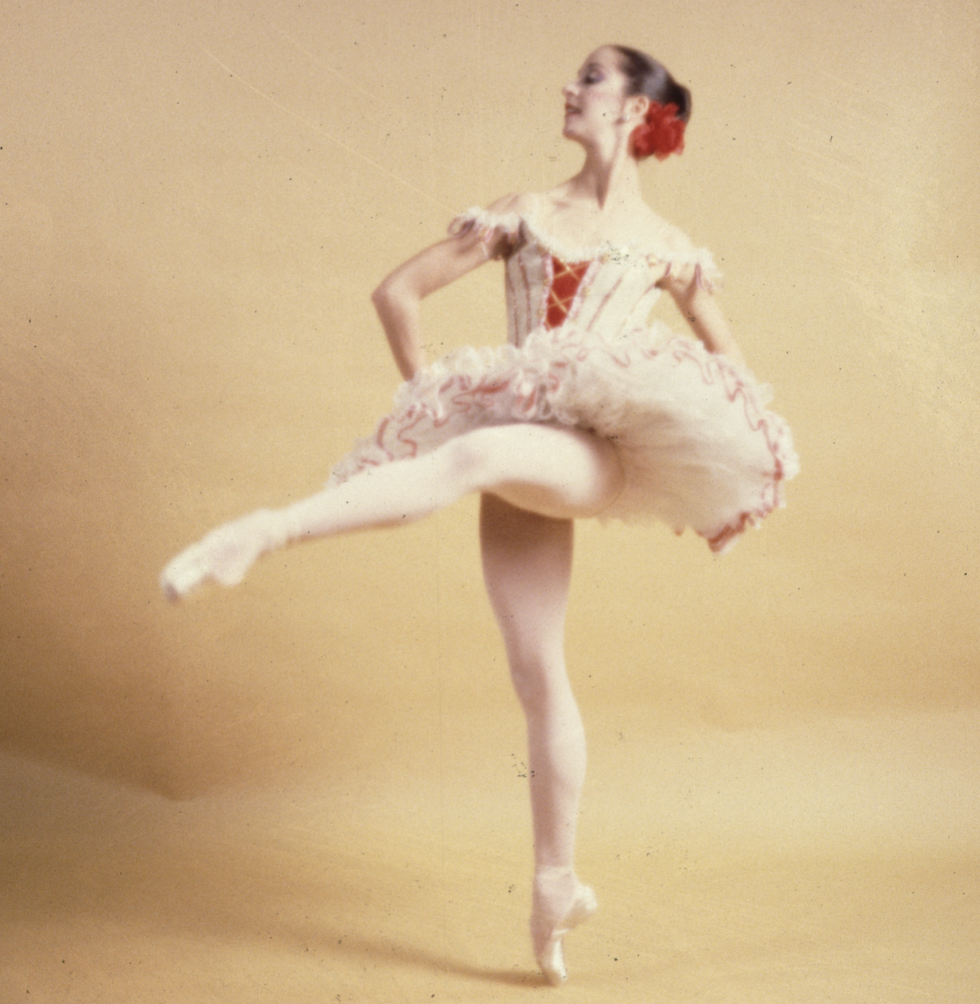 Cheryl Yeager in front attitude on pointe in a Kitri costume