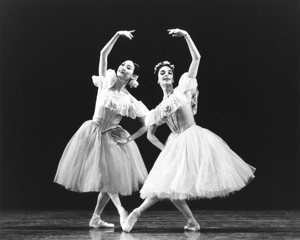 Yan Chen onstage with Alessandra Ferri in romantic tutus, leaning toward each other on a bent pli\u00e9 leg