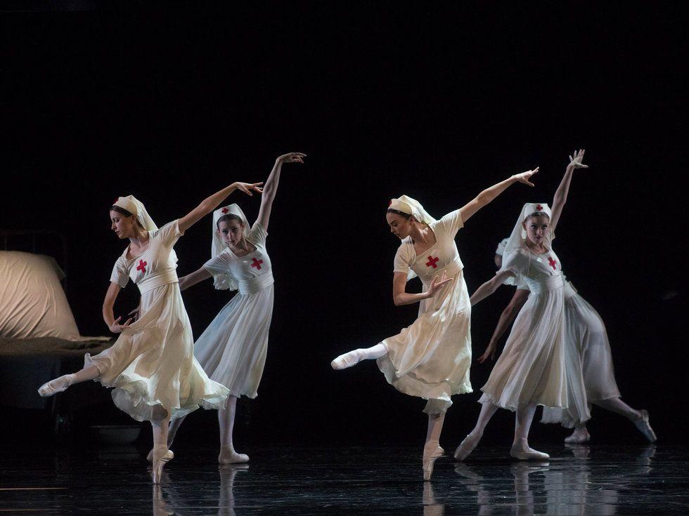 Four dancers in nurse costumes