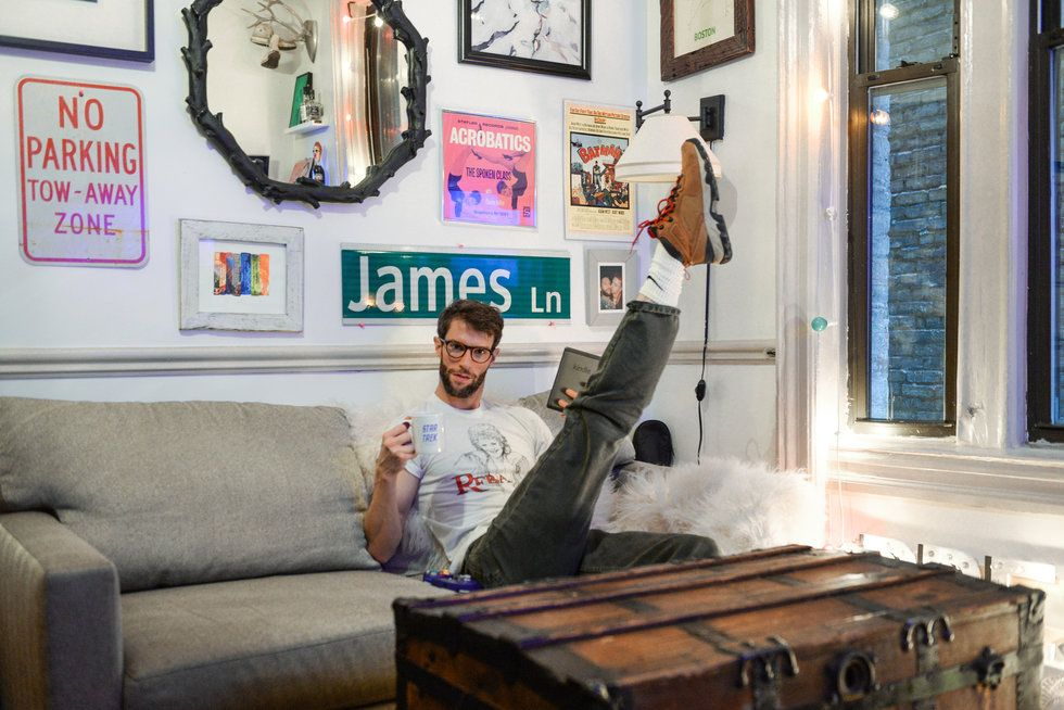 James Whiteside shows off his developpe front from his couch in his apartment