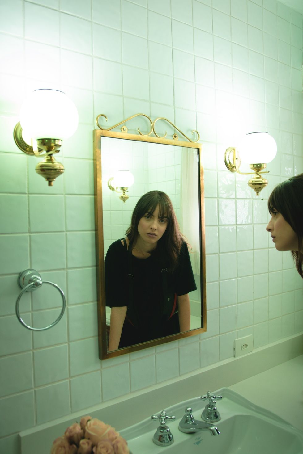 https://www.pexels.com/photo/woman-in-black-t-shirt-staring-on-wall-mirror-2043599/