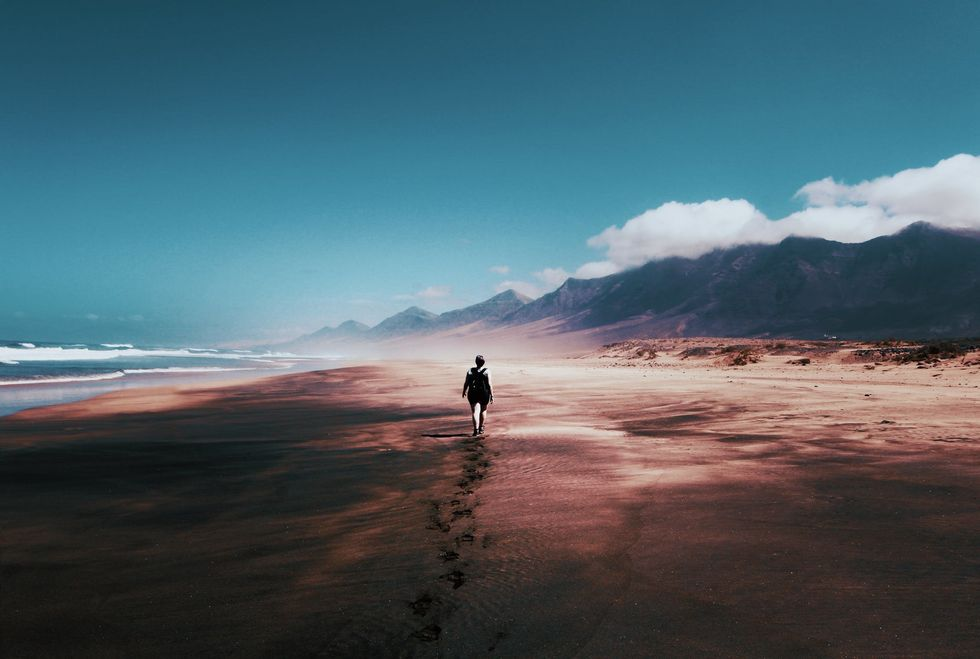 https://www.pexels.com/photo/photo-of-person-walking-on-deserted-island-934718/