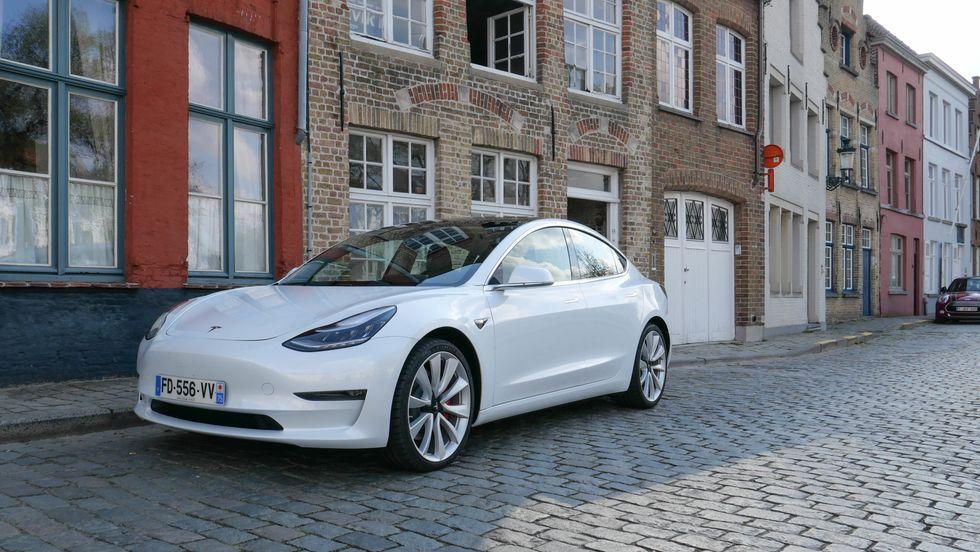 Photo of a white Tesla Model 3