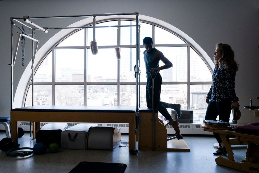 A dancer works out in Boston Ballet's Pilates room