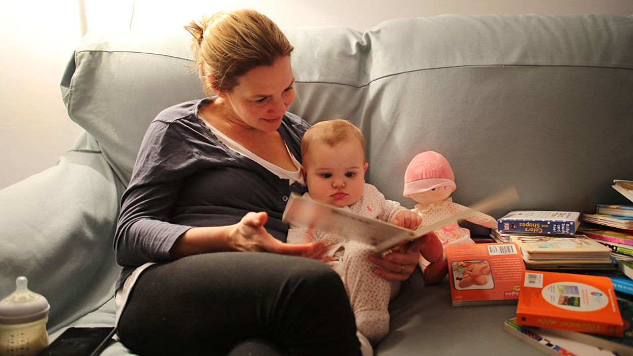 Reading to infants benefits both baby and adult, new research finds