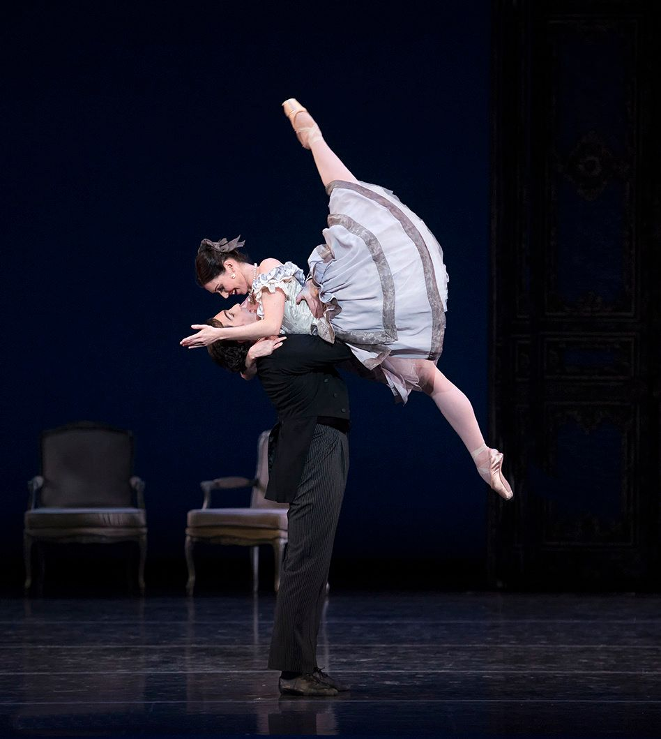 Kathleen Breen Combes is swept up into Yury Yanowsky's arms, her legs in a wide split