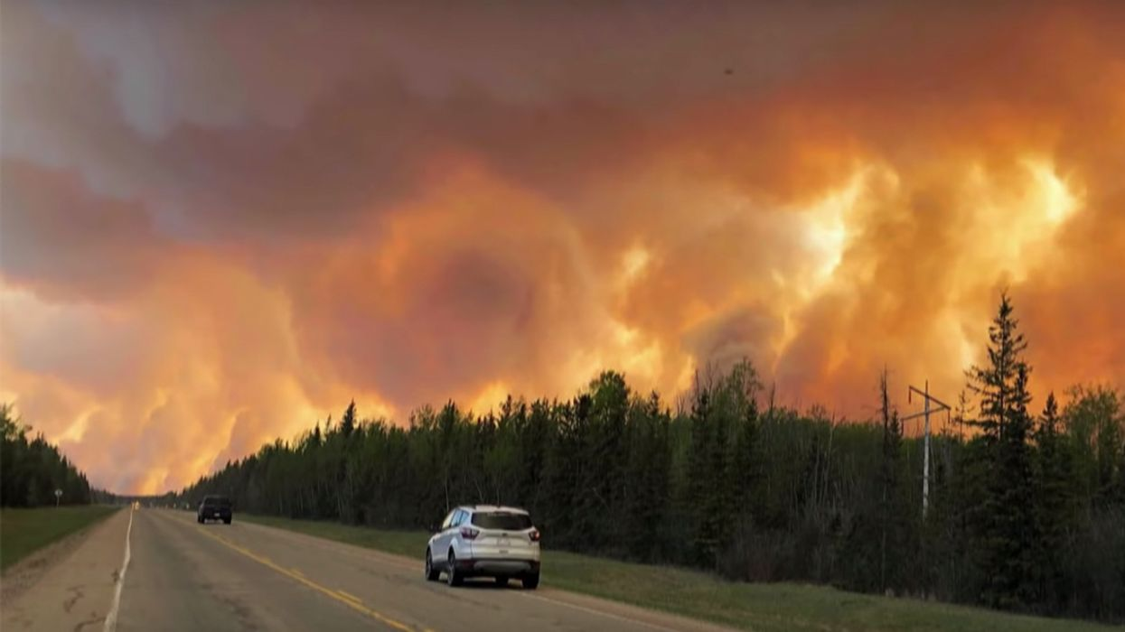 Wildfires Force 10,000 to Flee as Alberta Repeals Carbon Tax